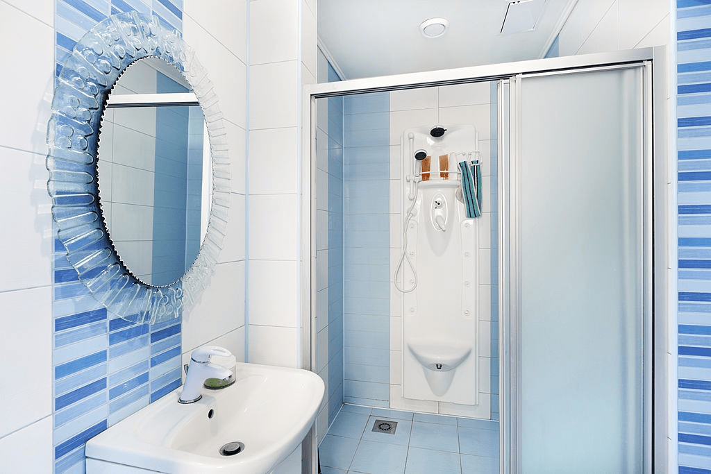 IS IT NECESSARY TO KEEP GLASS SHOWER DOORS CLEAN REGULARLY